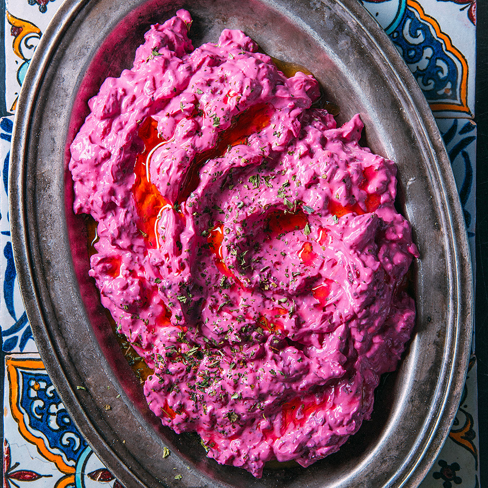 Borani, a Middle Eastern yogurt dip, can be made with anything from spinach to eggplant to carrots. This recipe gets its shockingly pink color from grated beets. Make it ahead--the longer it sits, the better it tastes. Source: EatingWell Magazine, September/October 2018