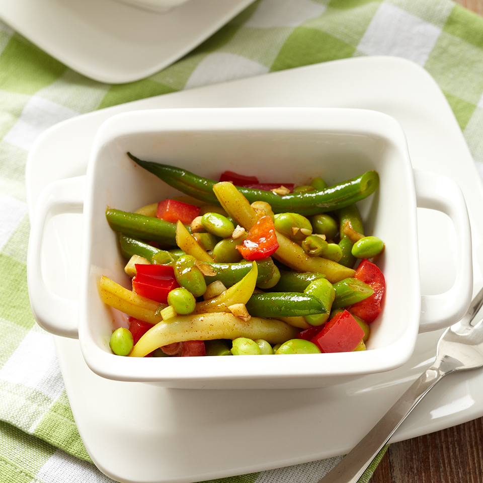 In this crisp side dish, fresh green beans and sweet peppers are joined with edamame in a sweet and spicy chili-lime dressing.
