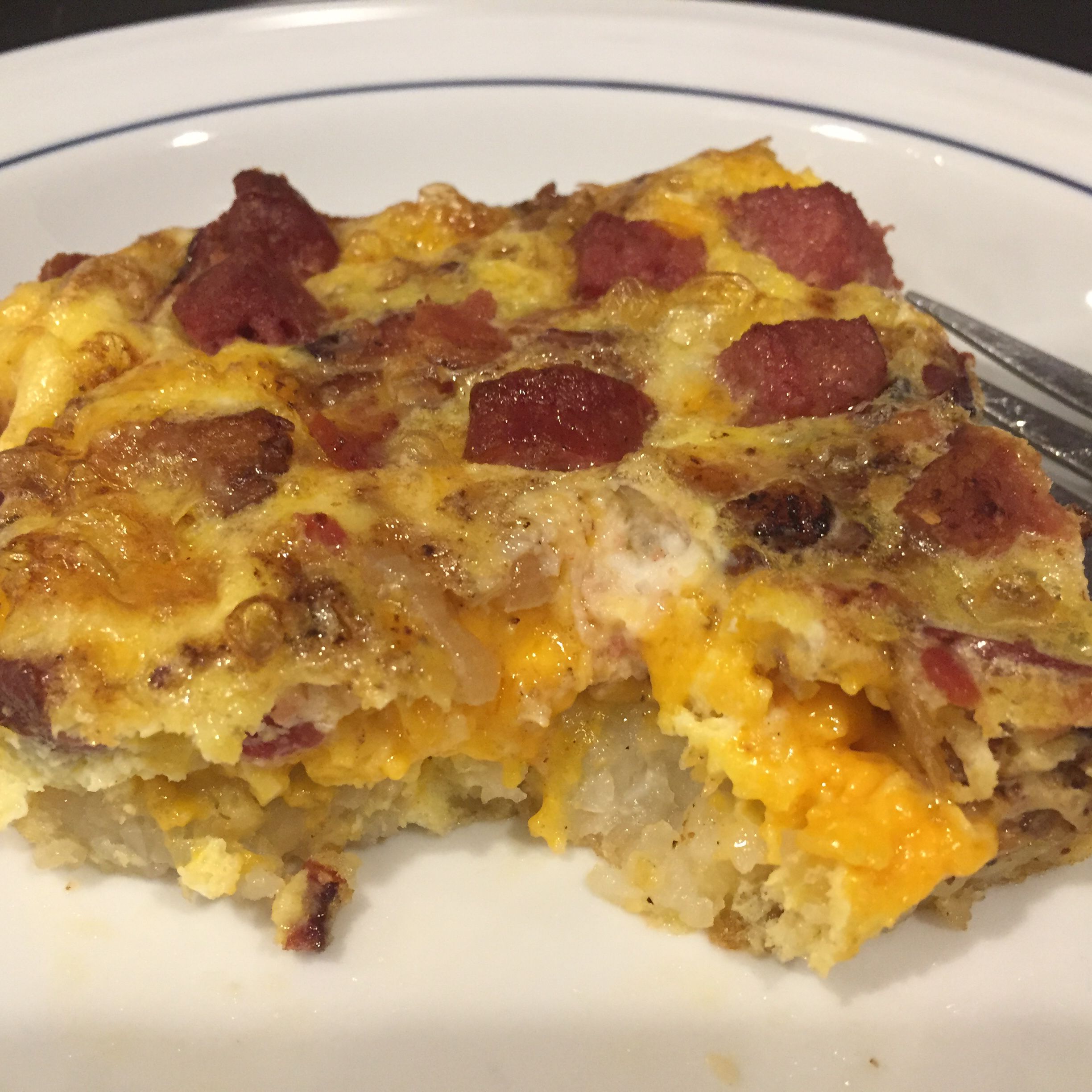 Cheesy Bacon-Sausage-Egg-Hash Brown Skillet