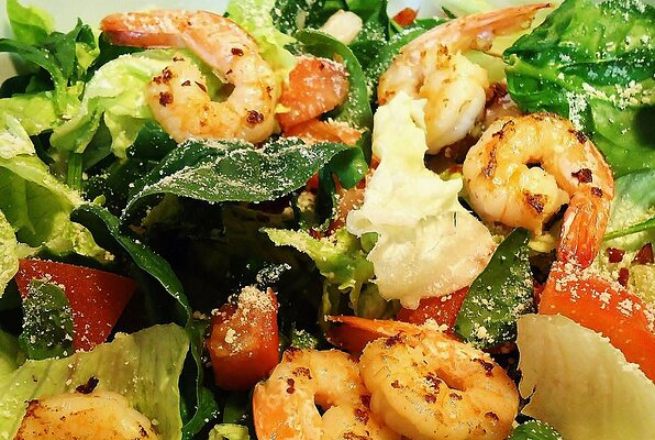 Greek-Style Shrimp Salad on a Bed of Baby Spinach