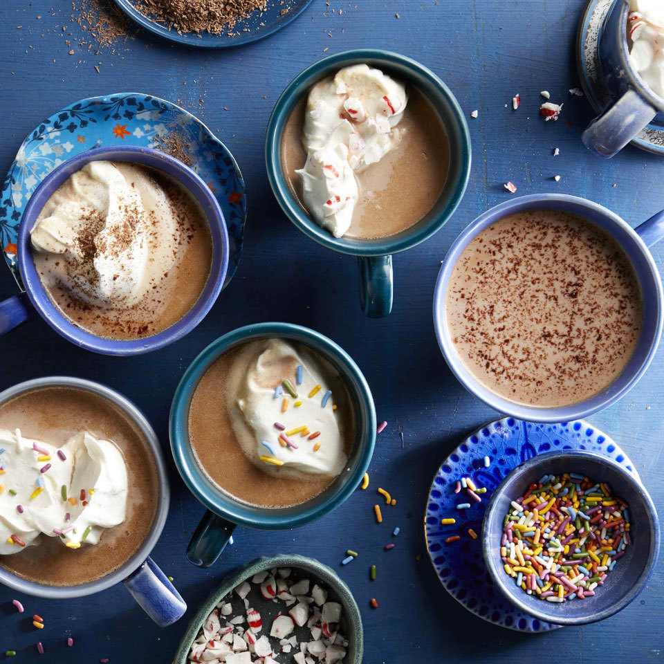 "Making hot chocolate in quantity in a slow-cooker is an easy make-ahead drink for parties. Once the hot chocolate is ready, you can use the ""keep warm"" setting to keep it hot throughout the gathering. Plus, take it to the next level by setting up a hot chocolate toppings bar with bowls of mini marshmallows, crushed peppermint candies, sprinkles, whipped cream and cinnamon sticks at the ready to stir into your cocoa."