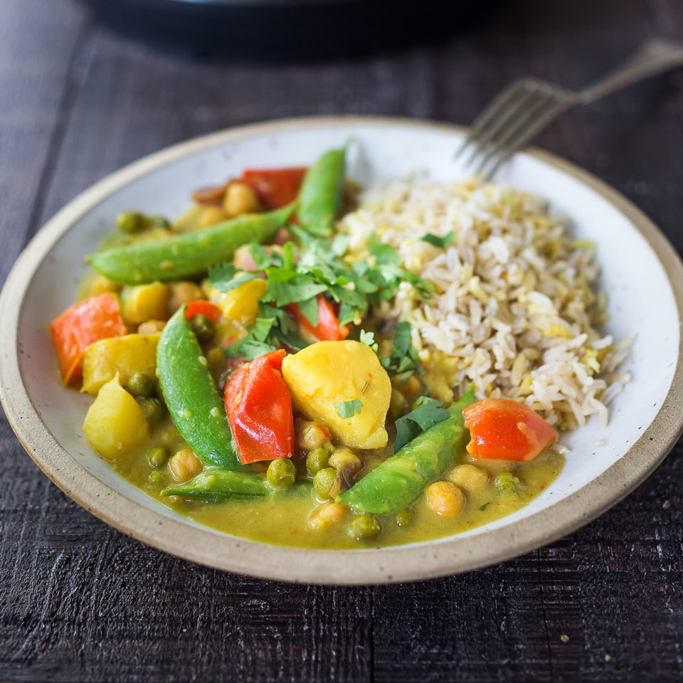 This vegetable curry comes together fast thanks to the help of a multicooker. Coconut milk makes it creamy, while keeping this easy dinner vegan, and the potatoes and chickpeas help bulk up the dish for a satisfying meal. Serve over basmati rice, quinoa or cauliflower rice.