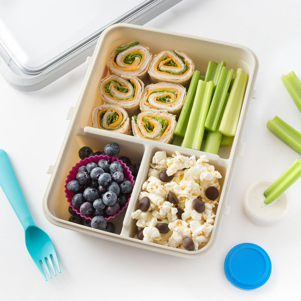 Bite-size pinwheels of turkey, cheese and lettuce make an appealing centerpiece of this bento box. Crisp celery sticks and juicy blueberries are tasty accompaniment, while popcorn, mixed with chocolate chips, makes a satisfying snack or dessert. Plus, this healthy lunch is so easy to pack and can even be made the night before.Source: EatingWell.com, September 2018