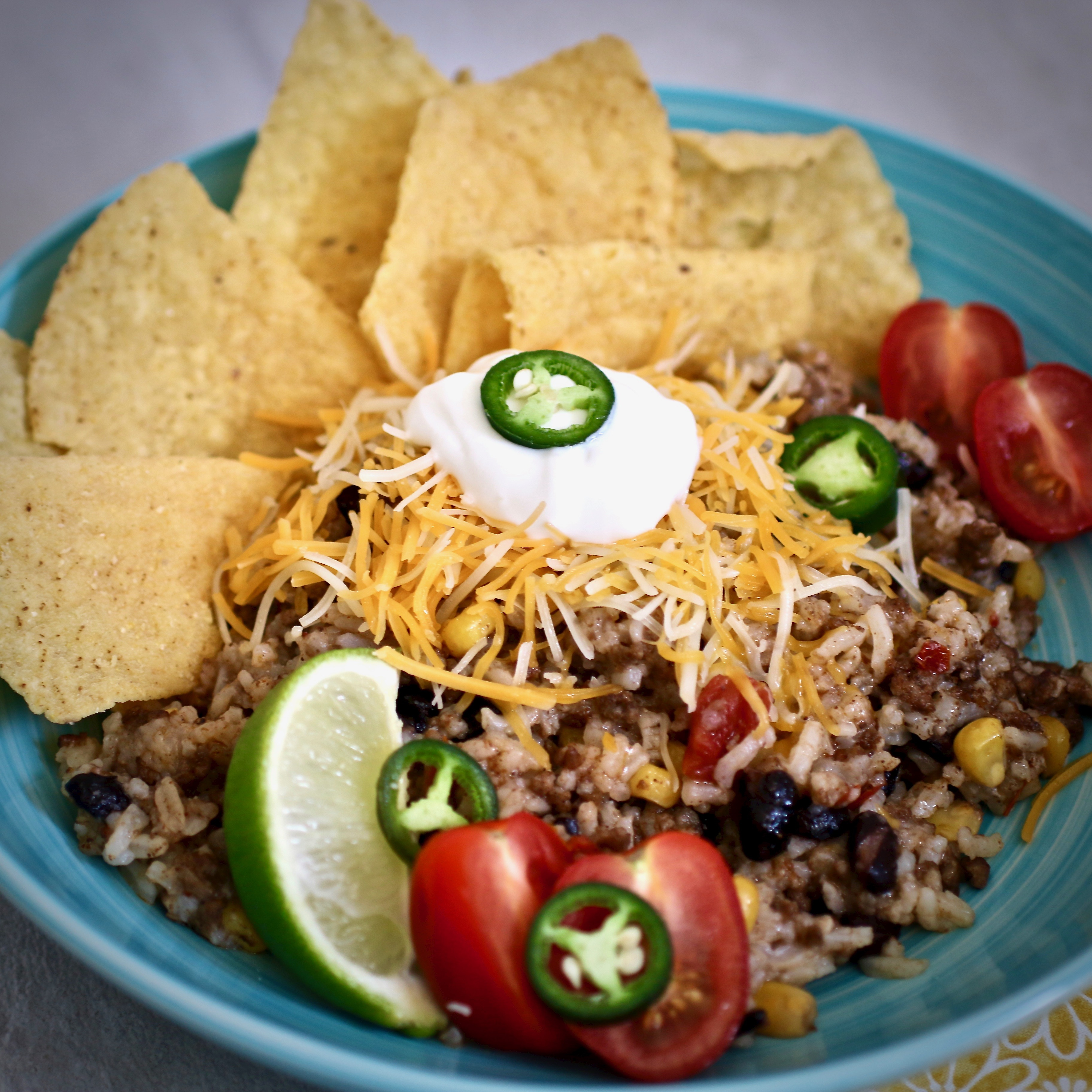 """Another easy Instant Pot recipe! This one features ground beef, black beans, corn, and rice. Top it off with cheese and serve in lettuce wraps. """"Boston lettuce is optional for serving as lettuce wraps,"""" says Cori S."""