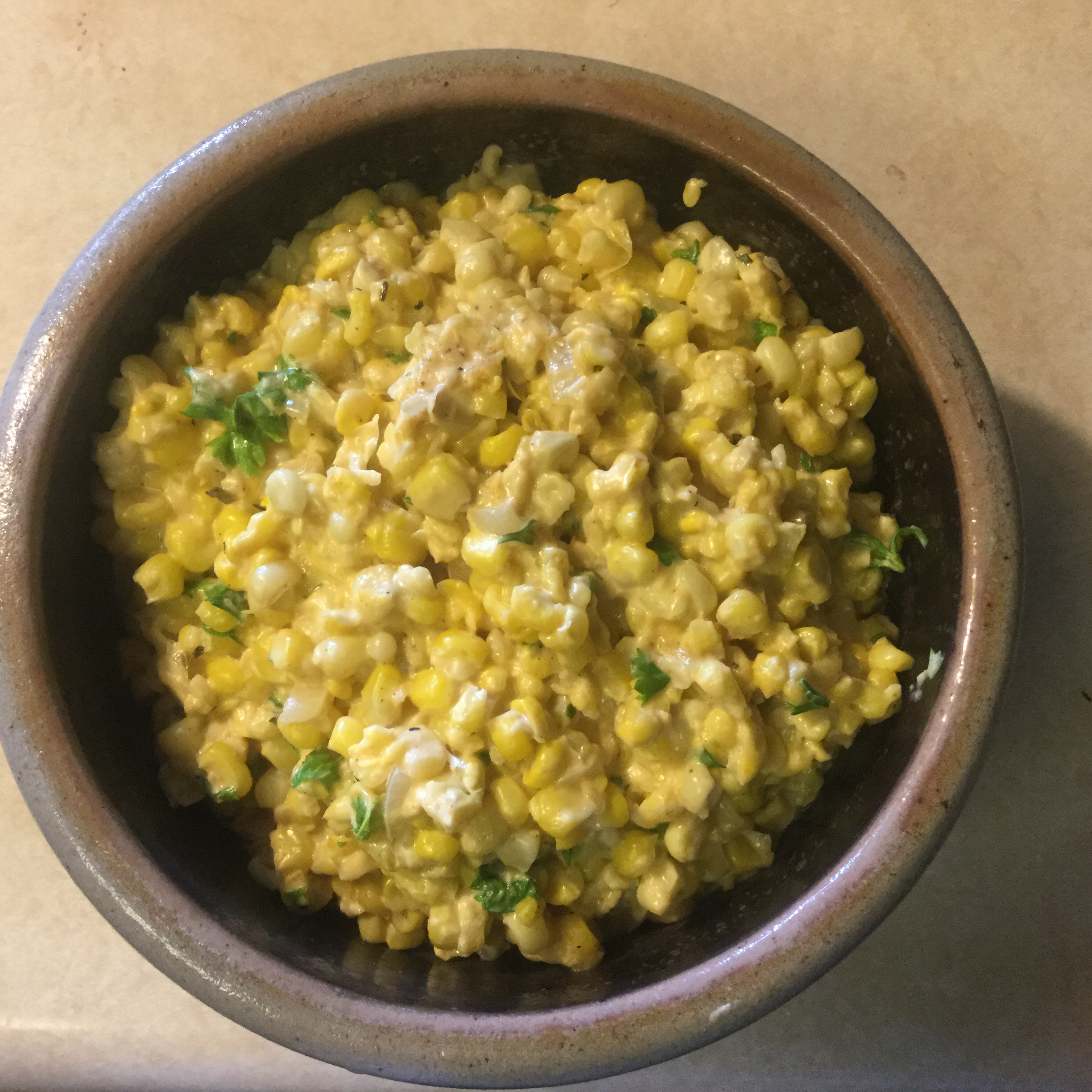 """Cheesy corn is a popular side at Kansas City BBQ joints. """"Really tasty recipe and I like the crunch of the corn once it's chilled & gets cold!"""" says LAA. """"I use Cajun seasoning instead of Creole b/c it's something I keep on hand in my pantry. Highly recommend."""""""