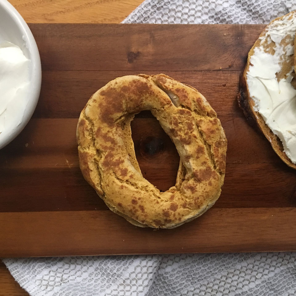 Give easy two-ingredient dough bagels a fall-flavor makeover with this genius hack. We've replaced half the Greek yogurt in our traditional two-ingredient dough with pumpkin puree and added in a little pumpkin spice. Five ingredients are all you need for this special, yet healthy, breakfast treat.Source: EatingWell.com, October 2018