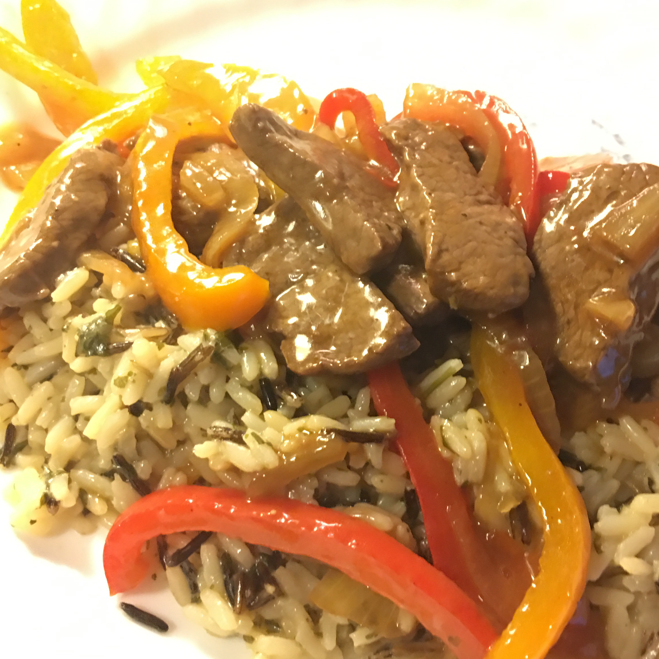 Venison Steak with Peppers and Onions