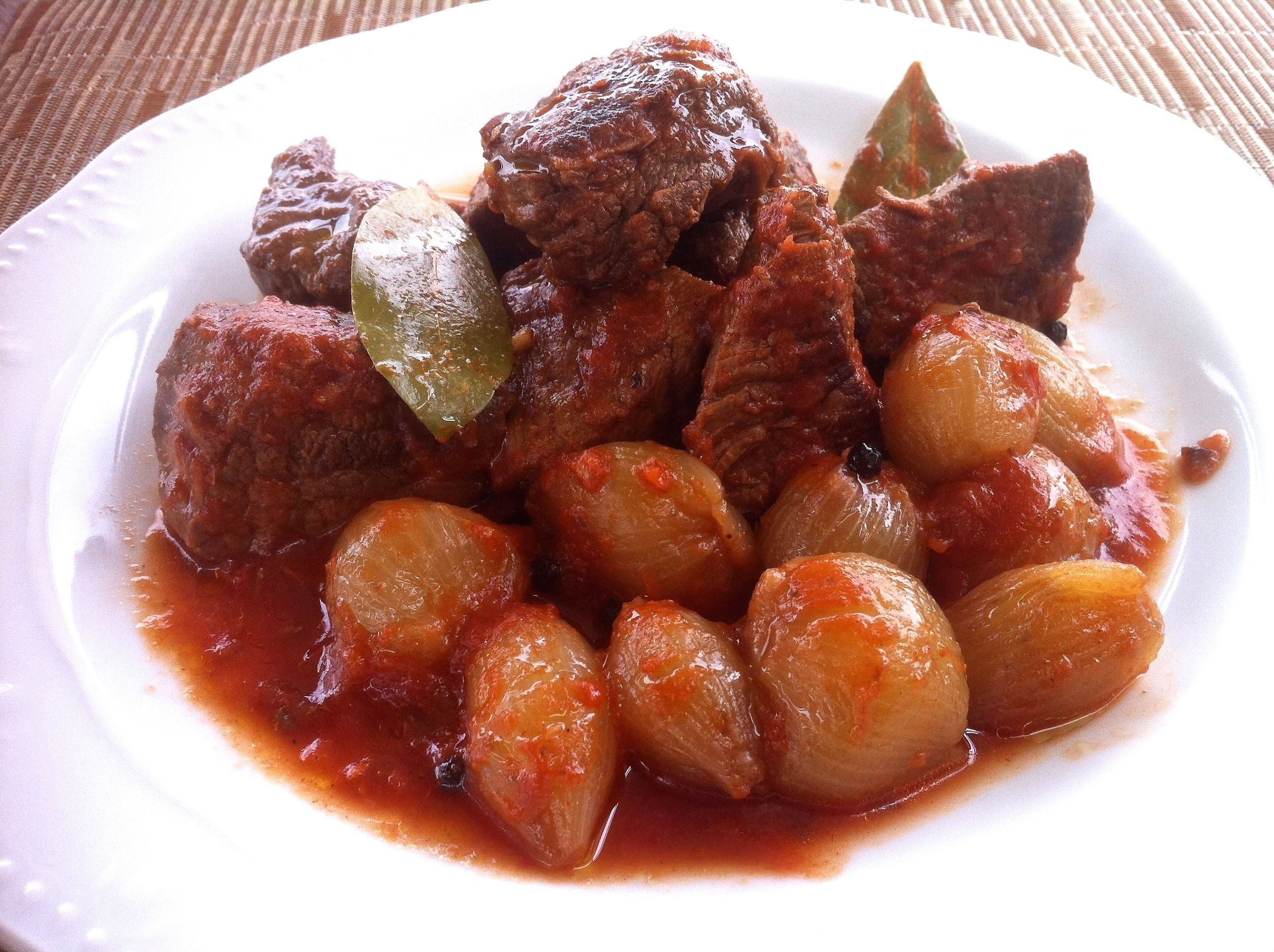 """""""Stifado is a Greek beef stew and my all-time favorite Greek dish,"""" says waz71. """"Chunks of tender beef are cooked with shallots in a rich aromatic tomato sauce. Serve with boiled rice and a good supply of crusty bread to mop up the rich sauce!"""""""