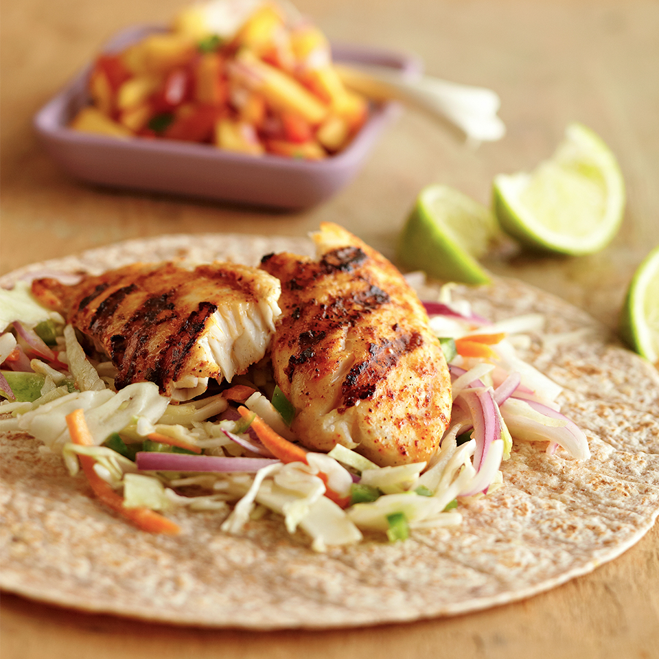 A citrus-jalapeño slaw adds a zesty and delicious crunch to these fish tacos. Add some sweetness to each bite by serving with peach or mango fruit salsa.