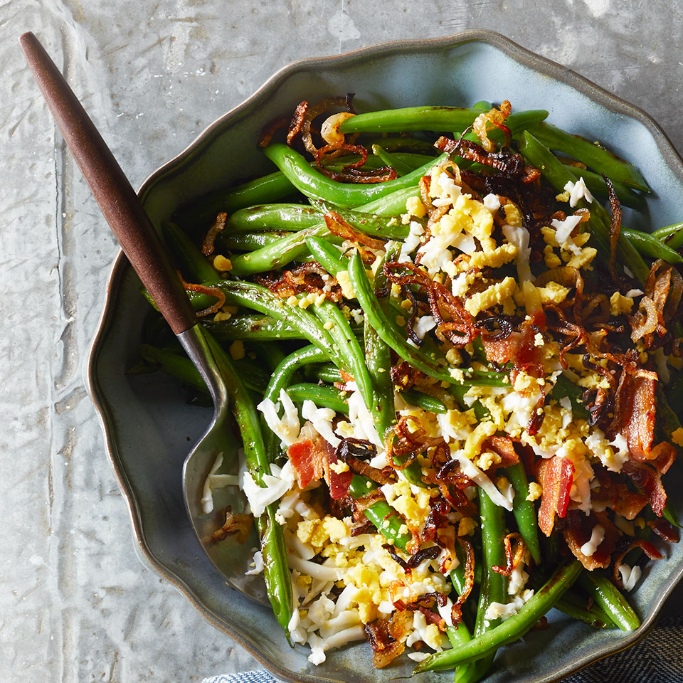 The secret to this delicious green bean recipe is cooking the vegetables in the oil that you fry the bacon and shallots in—a great decadent alternative to green bean casserole!