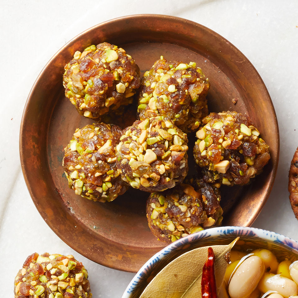 A touch of sweetness from the dates and raisins paired with crunch and nuttiness from the pistachios make these bites perfect for an on-the-go snack or as an accompaniment on a cheese board.