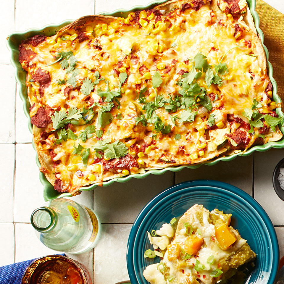 Skip rolling and just layer these quick and easy enchiladas. This recipe uses a quick blender sauce, but if you're short on time, pick up a can of your favorite red enchilada sauce in the international aisle of your grocery store--you'll need about 3 cups. Source: EatingWell Magazine, November/December 2018