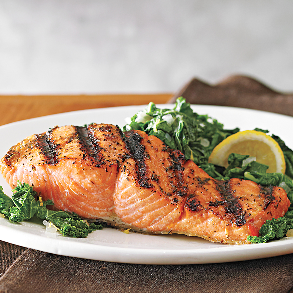 In this healthy dinner recipe, salmon fillets are seasoned with a zesty dry rub, grilled and served with a simple side--lemon-seasoned sautéed kale and shallots. Sometimes simple is best! Source: Diabetic Living Magazine