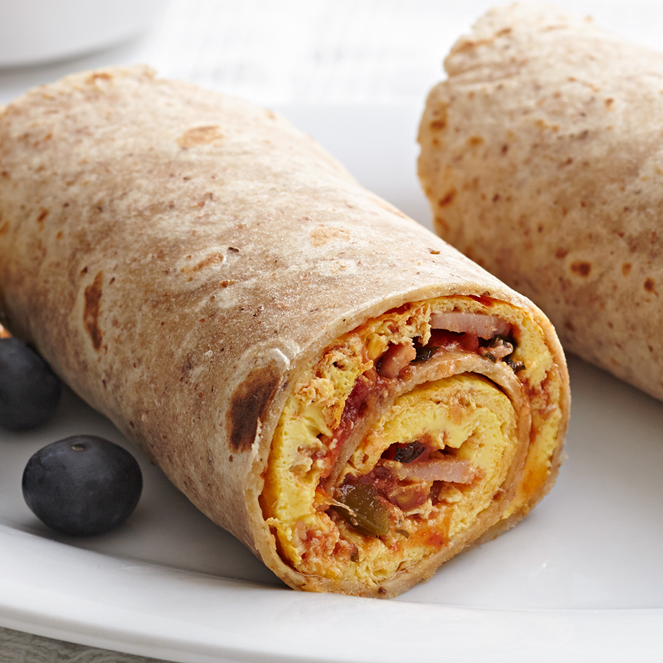 This breakfast burrito is quick to make and easy to eat. Ham, egg and a dash of hot sauce cook up into an omelet and get rolled up in a delicious high-fiber tortillafor some fun fork-free eating. Source: Diabetic Living Magazine