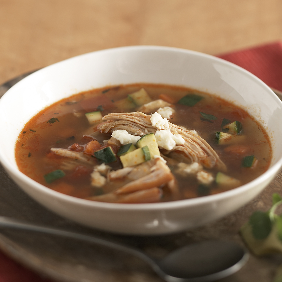 Leftover turkey is not just for sandwiches! This hearty soup recipe is full of shredded turkey and vegetables and the tasty toppings--cilantro, avocado and queso fresco--are what may just have you coming back for that second dish. Queso fresco is a mild Mexican cheese with a crumbly texture, similar to that of feta or farmer's cheese. Look for it at Hispanic food markets or larger grocery stores.