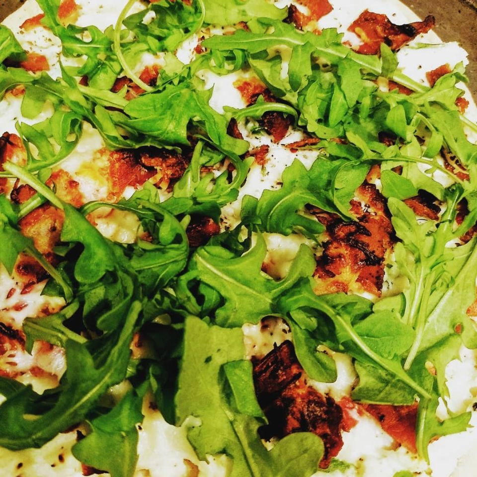 """A creamy and savory pizza topped with fresh nutty flavored arugula and drizzled with a splash of fresh lemon juice,"" says Anna Shoeman. ""Perfect for a Friday night at home, by the fire with a glass of wine!"""