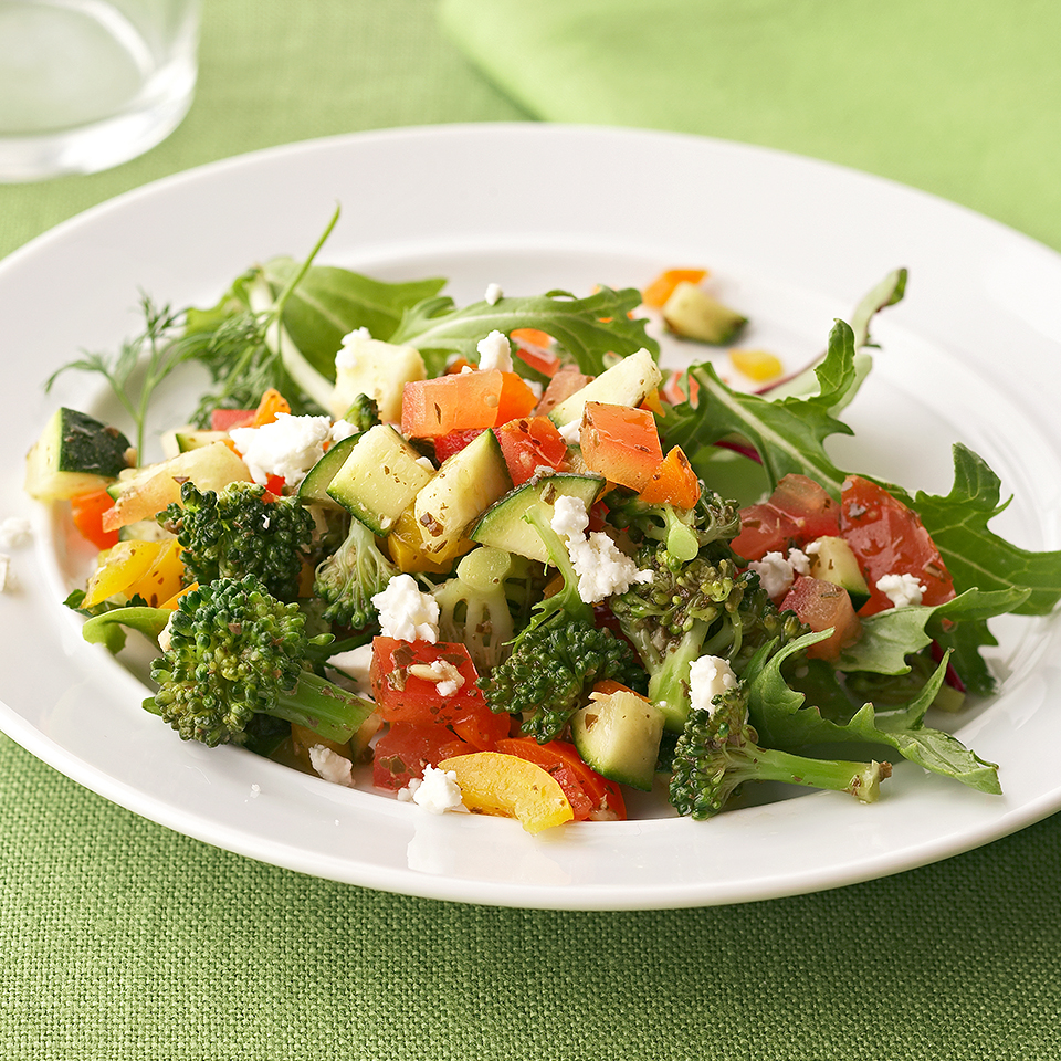 Chopped vegetables take on a Mediterranean flair in this quick and easy salad recipe. Flavored with a simple pesto vinaigrette and topped with crumbled feta cheese, this salad serves two and is ready in just 20 minutes.