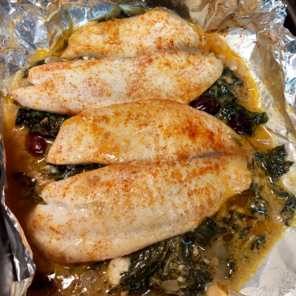 "Plenty of Mediterranean flavors in this tilapia dinner: olive oil, lemon, garlic, and feta cheese.  It's served Florentine-style with fresh spinach. ""A very clean, fresh, and satisfying Mediterranean dish,"" says Eddie Riddell."