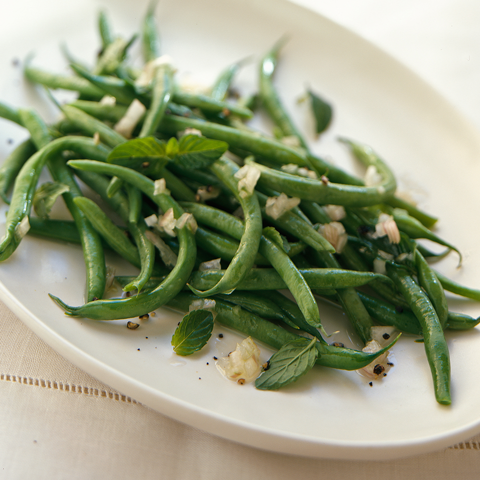 Thin green beans cook quickly, so rinsing them with cold water (or putting them into an ice water bath) is important if you want to keep them crisp. The beans in this side dish recipe takes only 20 minutes to prepare, but taste their best after a couple hours in the fridge where they soak up the flavor of the shallot-thyme mixture.