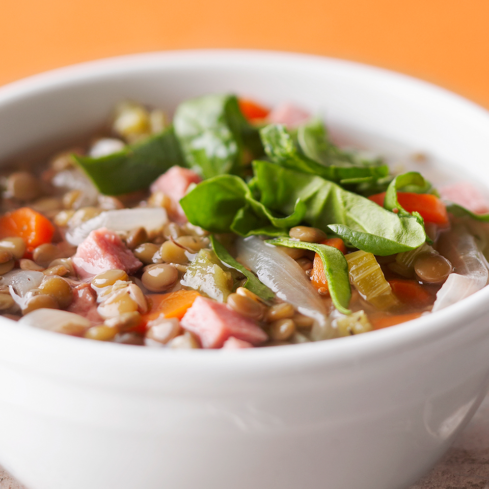 No ideas for dinner tonight? This slow-cooker lentil soup is easy to prepare in the morning and will simmer all day while you're at work. Full of aromatic vegetables, brown lentils, diced ham and fresh spinach, this hearty soup will be a real treat after a long day at the office.