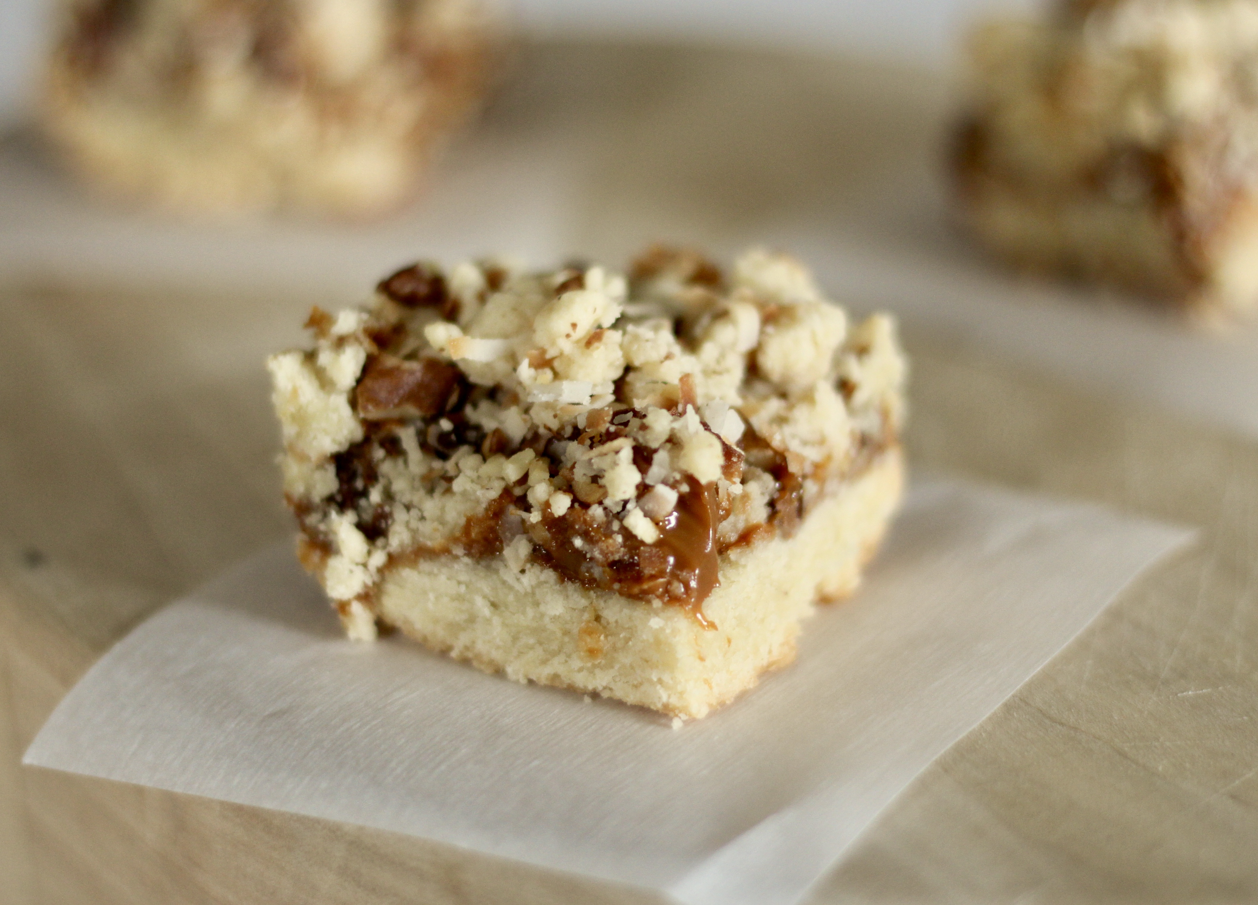 """""""A creamy center fills a shortbread-like buttery crust with a crumble-pecan coconut topping,"""" says Cori, the recipe submitter. """"This is a favorite with my family, boyfriend and at my workplace (a bakery!). Best served cool or room temperature."""""""