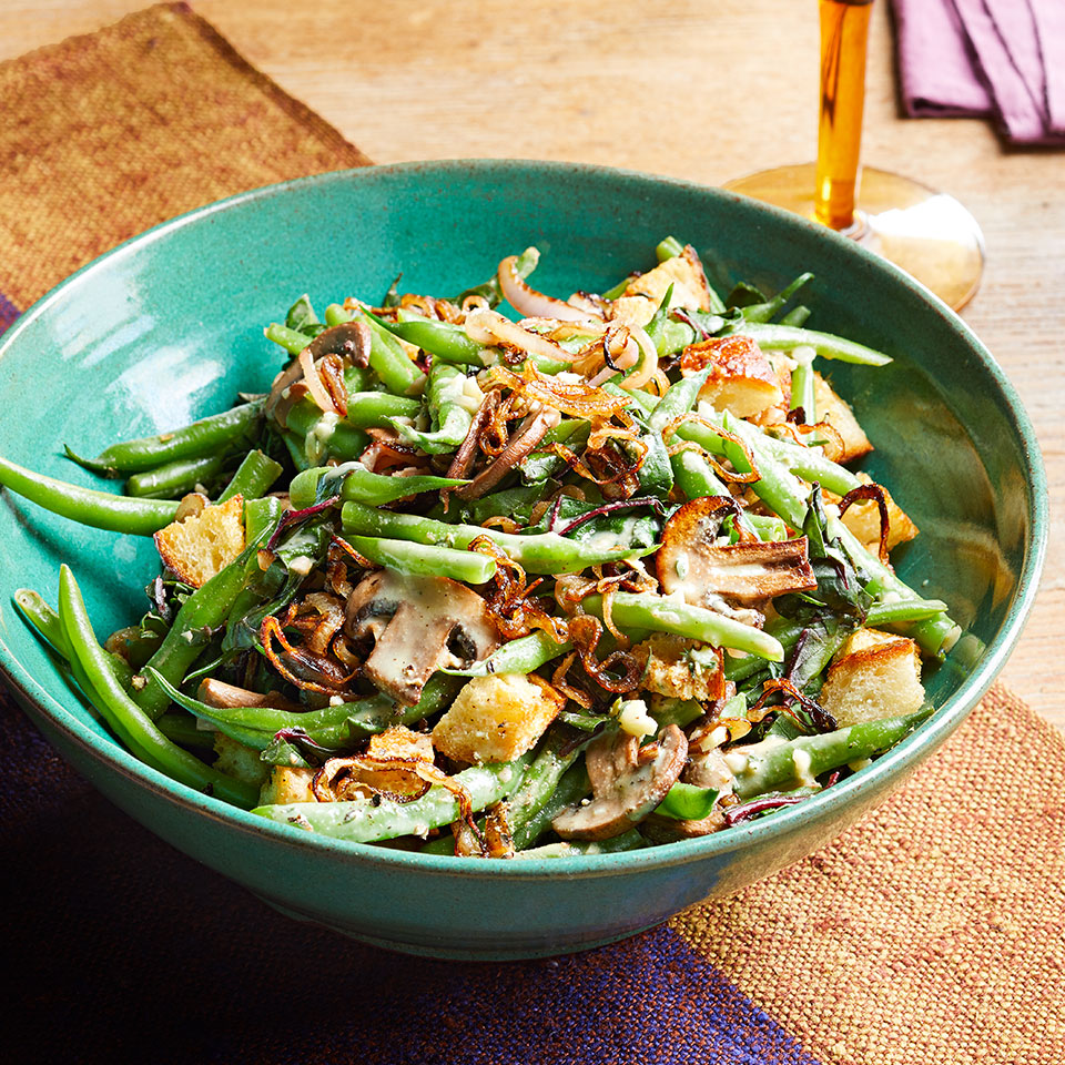 Trying to lighten up your green bean casserole? Try this quick and easy salad version, which combines fried shallots, croutons, mushrooms, green beans, and chopped chard leaves for a lighter take on a holiday classic.