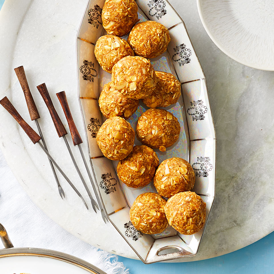 These easy pumpkin-spiced coconut oat balls make a great, packable afternoon snack or a delicious party appetizer.