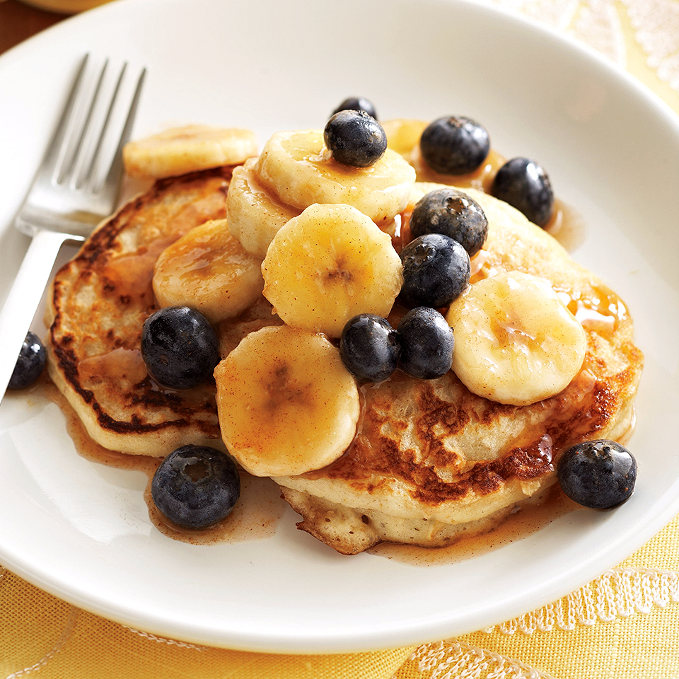 Have a full house and need a breakfast idea? Here's a quick pancake recipe that serves eight! Everyone at your table will enjoy these filling oatmeal-buttermilk pancakes, topped with fresh fruit and a decadent cinnamon-maple sauce.