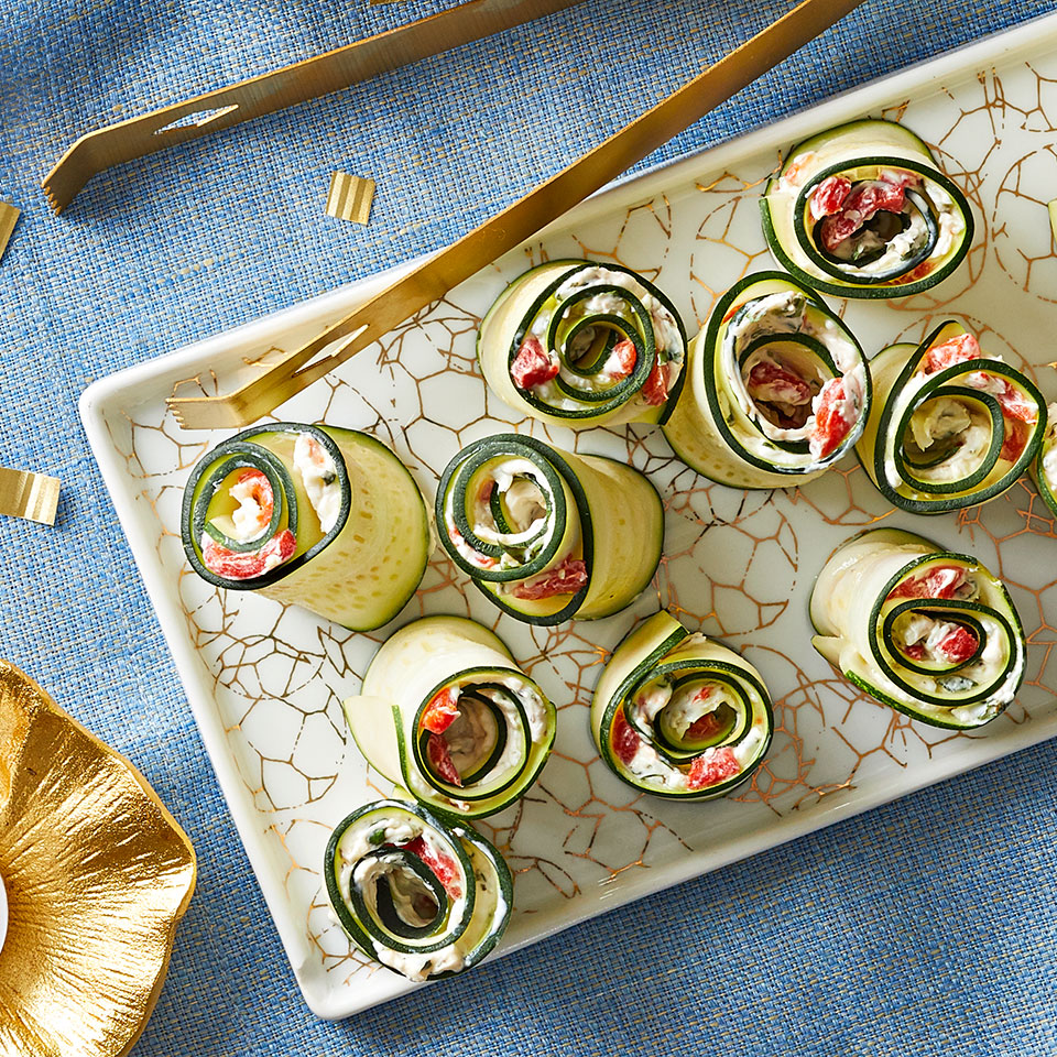 With a little time and a clever technique, zucchini and cream cheese are transformed into a playful and easy party snack. You will have leftover zucchini after shaving the ribbons; dice or slice the leftovers and use them in salads, omelets, or pasta. Source: Diabetic Living Magazine, Winter 2019
