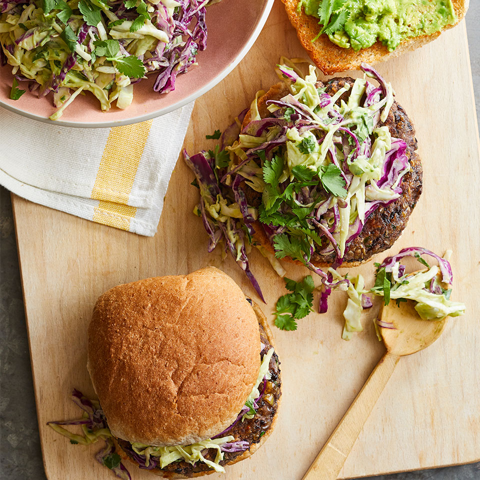 Lighten up your burger! Bean patties have less saturated fat and more fiber than beef patties. They're also cheaper and easier to cook indoors--and we promise they're just as satisfying, especially with the mouthwatering creamy slaw on top.