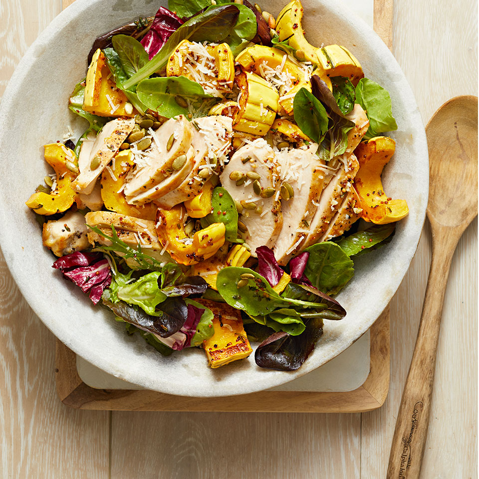 This hearty salad comes together with little effort, since the squash and chicken can roast together on the same sheet pan. Prep the dressing and the salad greens while the chicken is roasting.