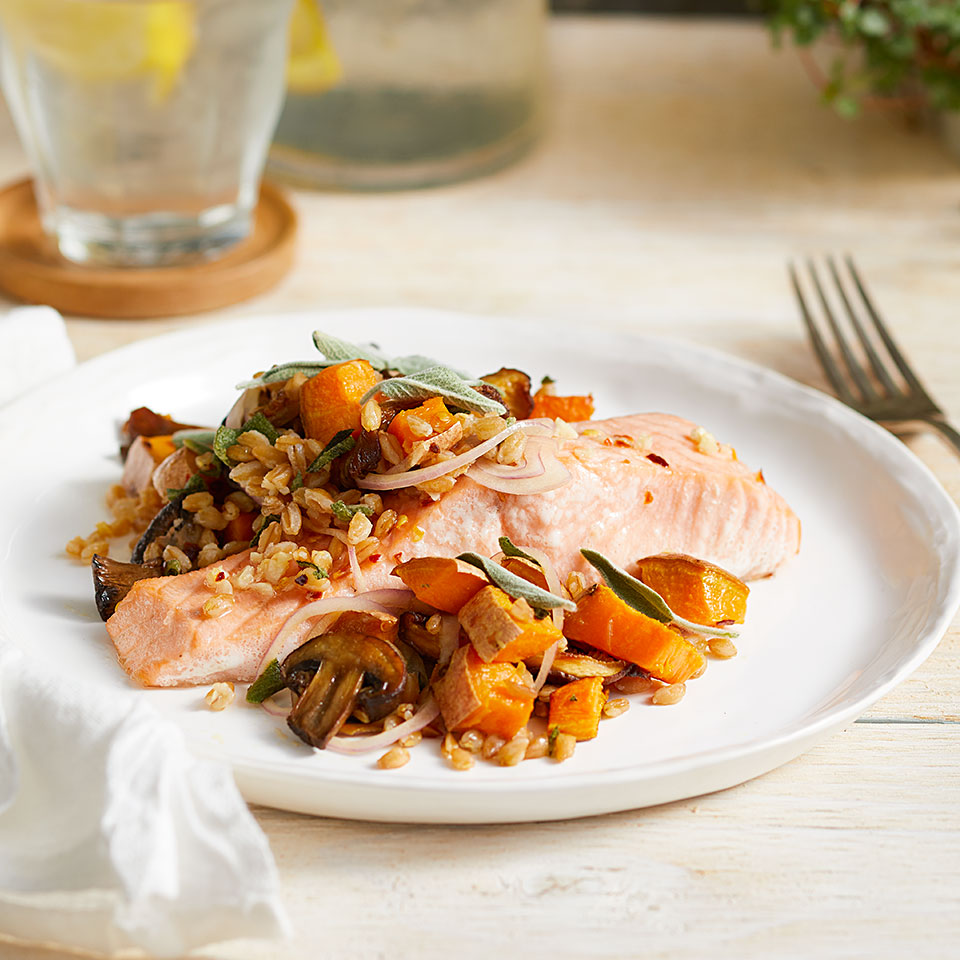 Farro is a type of wheat with large, plump grains that remain slightly al dente when cooked. If you can't find it, you can use bulgur instead. Both pair deliciously with the roasted vegetables and salmon, which are cooked on the same sheet pan for an easy, healthy meal.