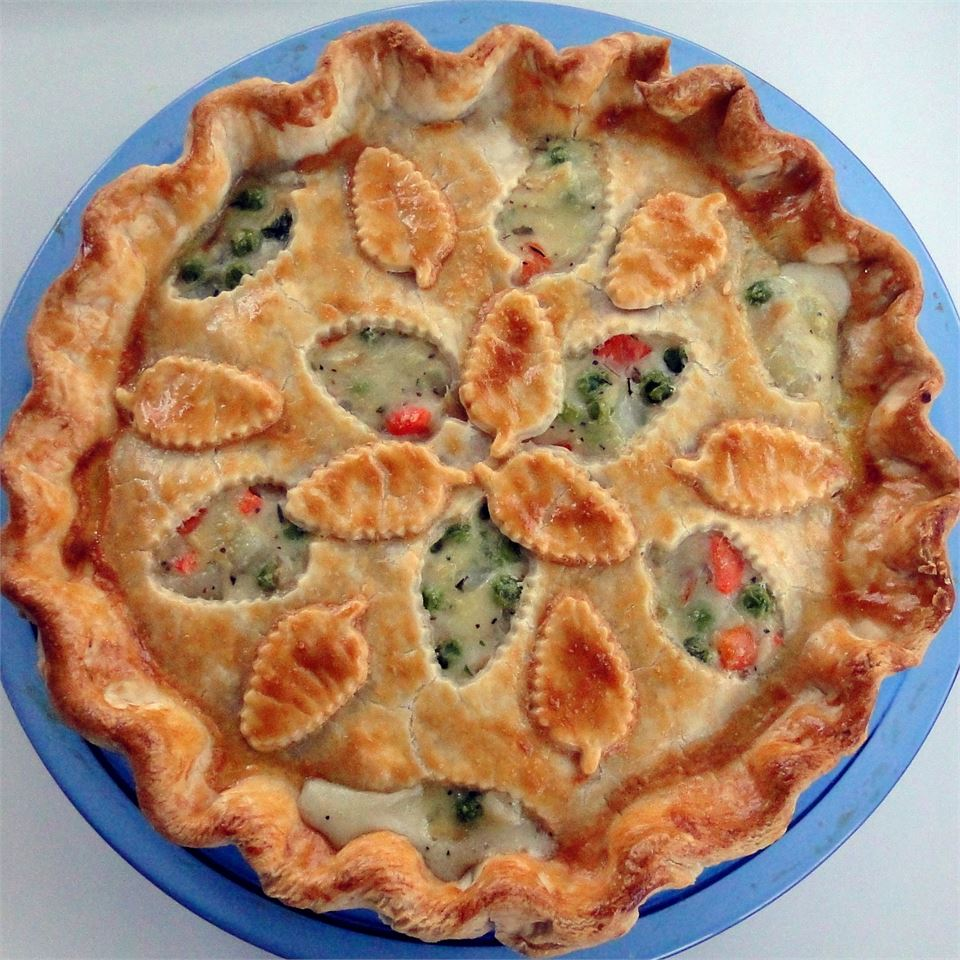If comfort food is what you're seeking for this Sunday dinner, chicken pot pie is the recipe to pick. This one is made in a pie dish (versus single-serving options made in muffin pans or custard cups), and you'll be boiling your chicken before making the pie filling. But to keep things more simple, this recipe uses a pre-made pie crust. You can be as creative as you want with any cut-outs.