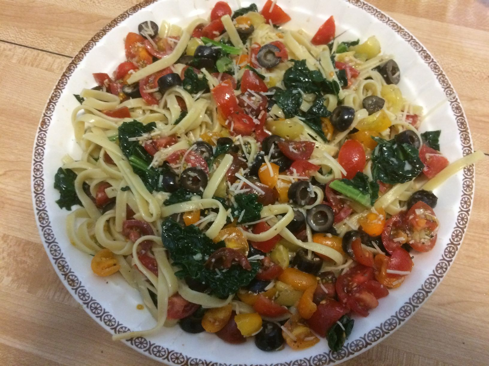Fettuccine with Kale and Tomato-Olive-Cream Sauce