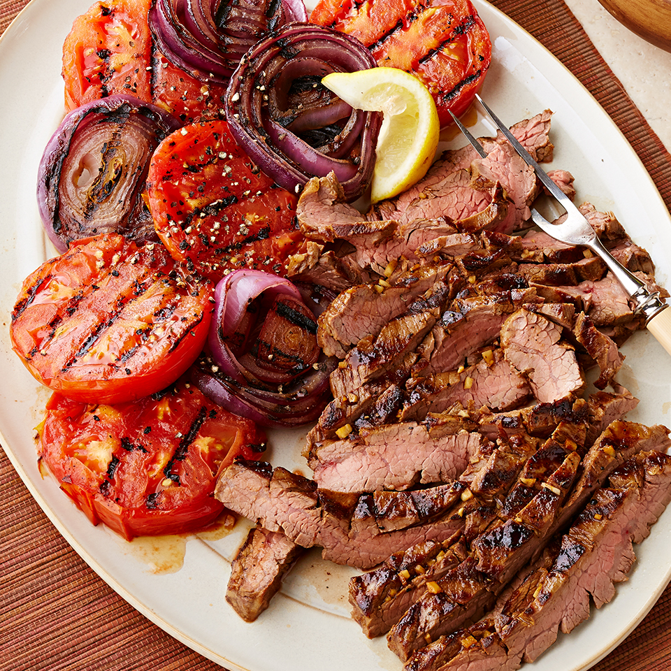 Molasses and mustard make a scrumptiously sweet and spicy marinade for this flank steak recipe. Served alongside grilled tomato and onion slices, this meal is sure to please everyone at your table. Source: Diabetic Living Magazine