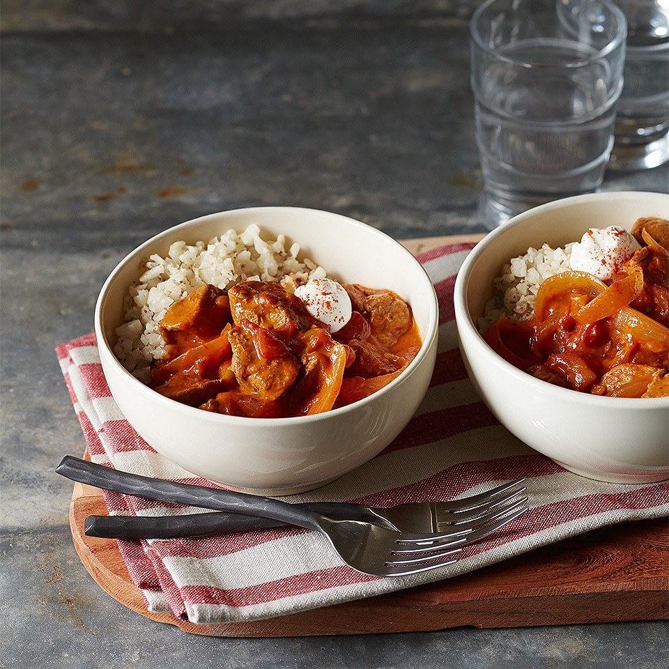 "Cut carbs and calories by using cauliflower ""rice"" instead of regular rice in this 30-minute pork paprikash recipe. Source: Diabetic Living Magazine"