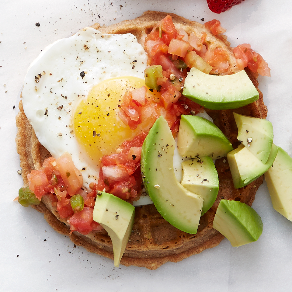 This open-faced egg sandwich has a bit of southwestern flair with avocado and fresh salsa. And while you'd normally expect it served on toast or an English muffin, we've switched things up by serving it on a whole-grain waffle.