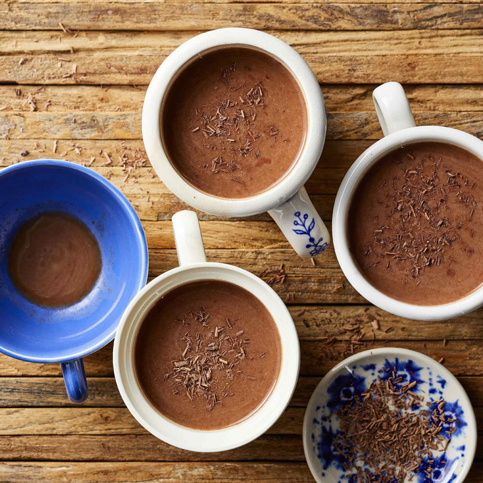 This stovetop hot chocolate starts with a delicately sweet coconut beverage. The subtle hints of vanilla help blunt the bitter edge of dark chocolate, and a splash of maple syrup makes this warm drink sweet and comforting.