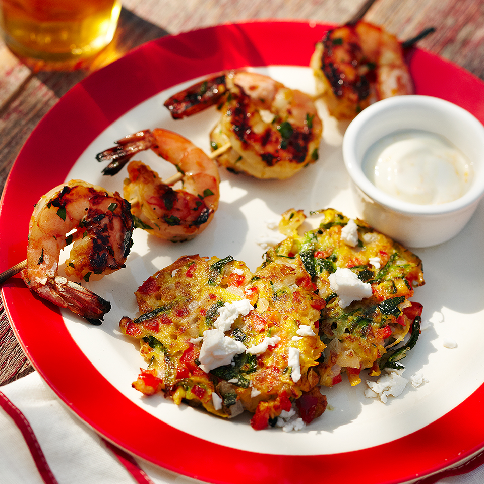Orange-ginger marinated shrimp are served alongside crispy zucchini fritters with a yogurt-based dipping sauce in this simple main dish recipe. Source: Diabetic Living Magazine