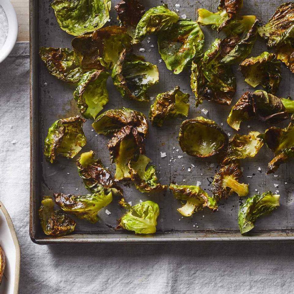 "If you like kale chips, you'll love these veggie chips too! The outer leaves of large Brussels sprouts make the best ""chips."" Plus, they're easier to remove than the tightly furled-together inner ones. Roast what's left over for dinner later in the week."