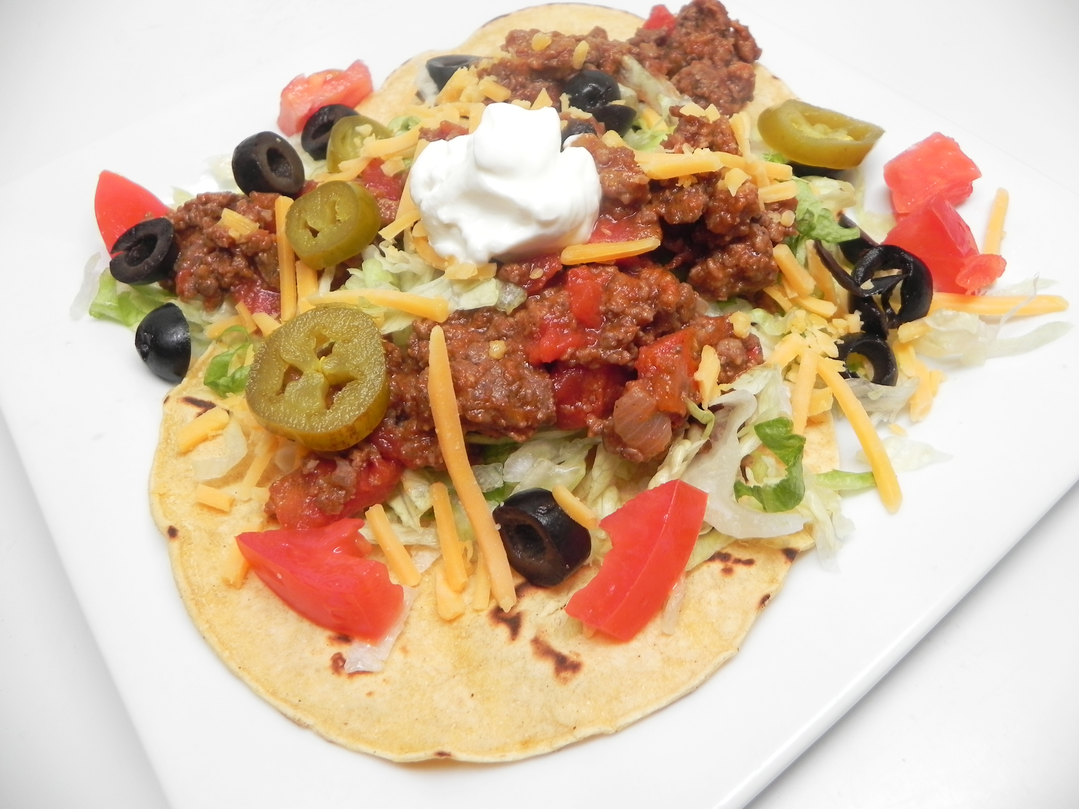 """""""This is a quick and simple recipe for delicious tacos made with ground beef and pork sausage, which gives the traditional recipe a nice twist,"""" says ANG03. """"Although they can be messy, they are so good, and perfect for busy weeknights. Try using the leftovers for nachos to mix it up a bit. Serve with your favorite taco toppings."""""""