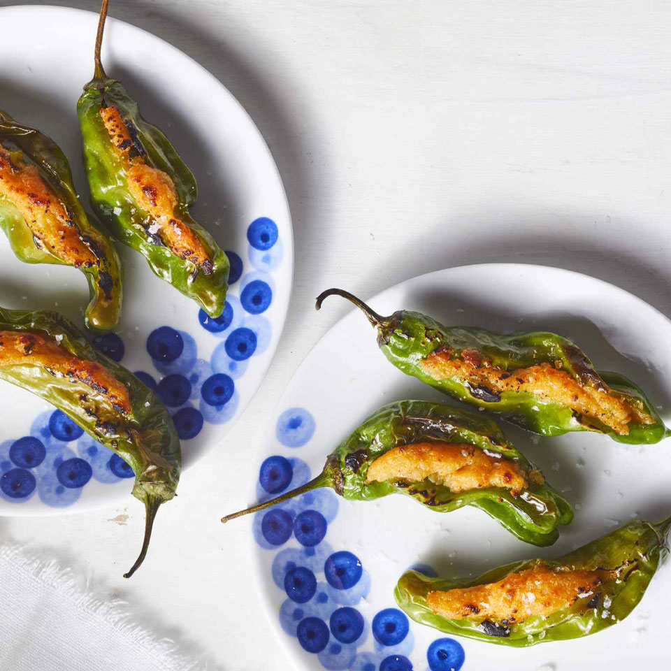 We used shishito peppers in this recipe makeover of classic game-day jalapeño poppers. They're typically mild, but 5 to 10 percent of them pack some heat, which makes eating them like a game of spicy roulette. Manchego is a sheep's-milk cheese made in Spain that has a buttery texture. Look for it in your supermarket's specialty-cheese section.Source: EatingWell Magazine, January/February 2019