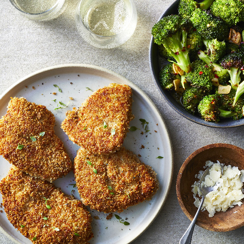 A little Parmesan in the pork chops' crunchy coating makes it extra-flavorful. The broccoli is simple yet special--try it alongside just about anything you're cooking, but it pairs perfectly with the pork here for a satisfying healthy dinner ready in just 30 minutes.