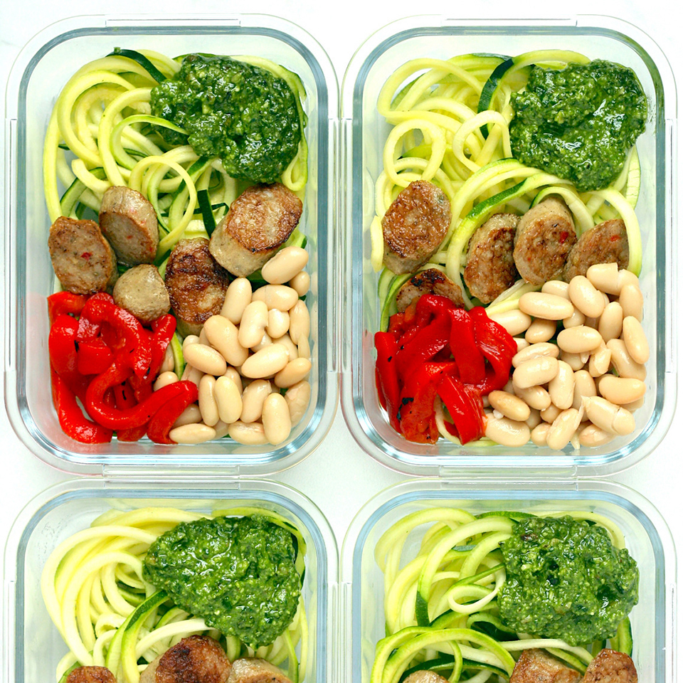 Cut down on prep time for this meal-prep zoodle recipe by using premade zucchini noodles from the produce section. Canned beans and precooked chicken sausage heat in about 5 minutes and add protein, while store-bought refrigerated pesto serves as a fast and flavorful topping. Source: EatingWell.com, January 2019