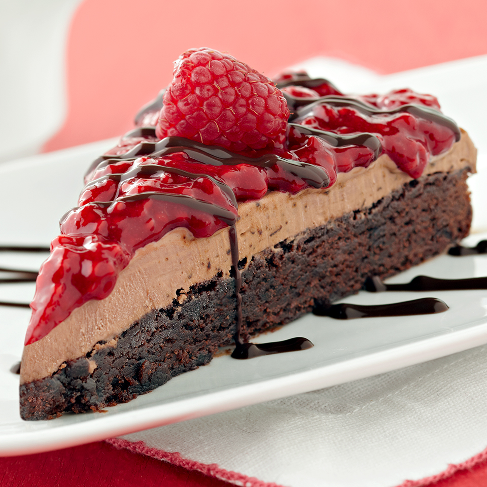 Who doesn't love a homemade ice cream cake? This dessert recipe is simple to make and so beautiful your guests won't believe you made it yourself. A chocolate brownie crust layered with mocha ice cream and topped with raspberry sauce, fresh raspberries, and chocolate syrup--it's so thick we recommend serving it with a long cake knife, a chef's knife, or a bread knife. Source: Diabetic Living Magazine