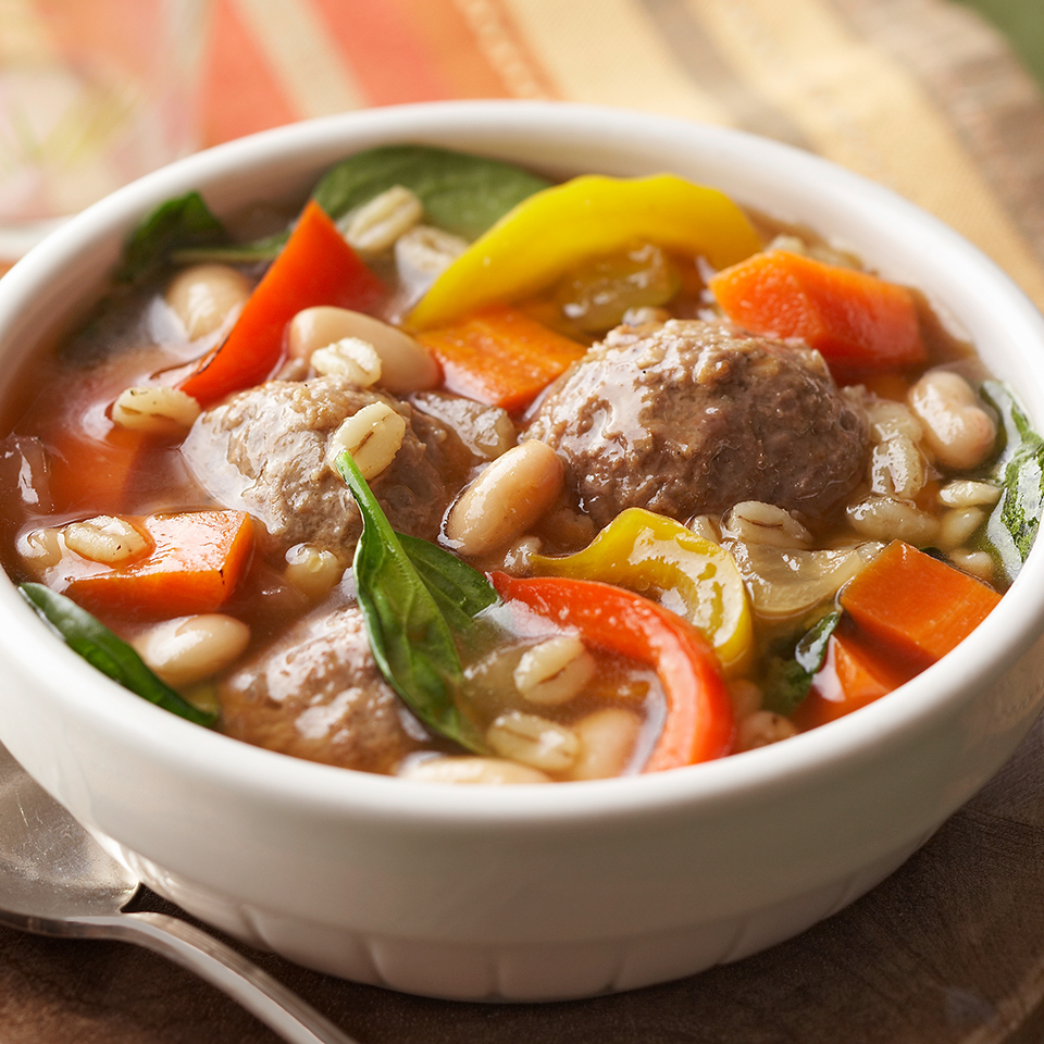 Homemade meatballs flavored with garlic and rosemary take center stage in this simple 1-hour soup recipe. Great Northern beans and barley add a healthy dose of protein and fiber to this hearty and filling dish.