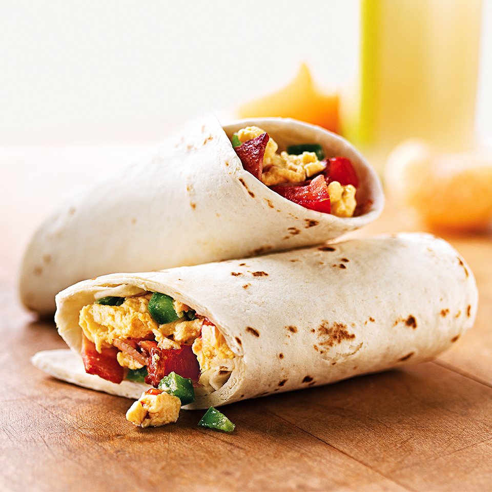 This bacon and egg omelet is loaded with turkey bacon, crunchy bell pepper, and fresh tomato. Rolled up in a warm tortilla, this quick-and-easy breakfast will keep you satisfied for hours.Source: Diabetic Living Magazine