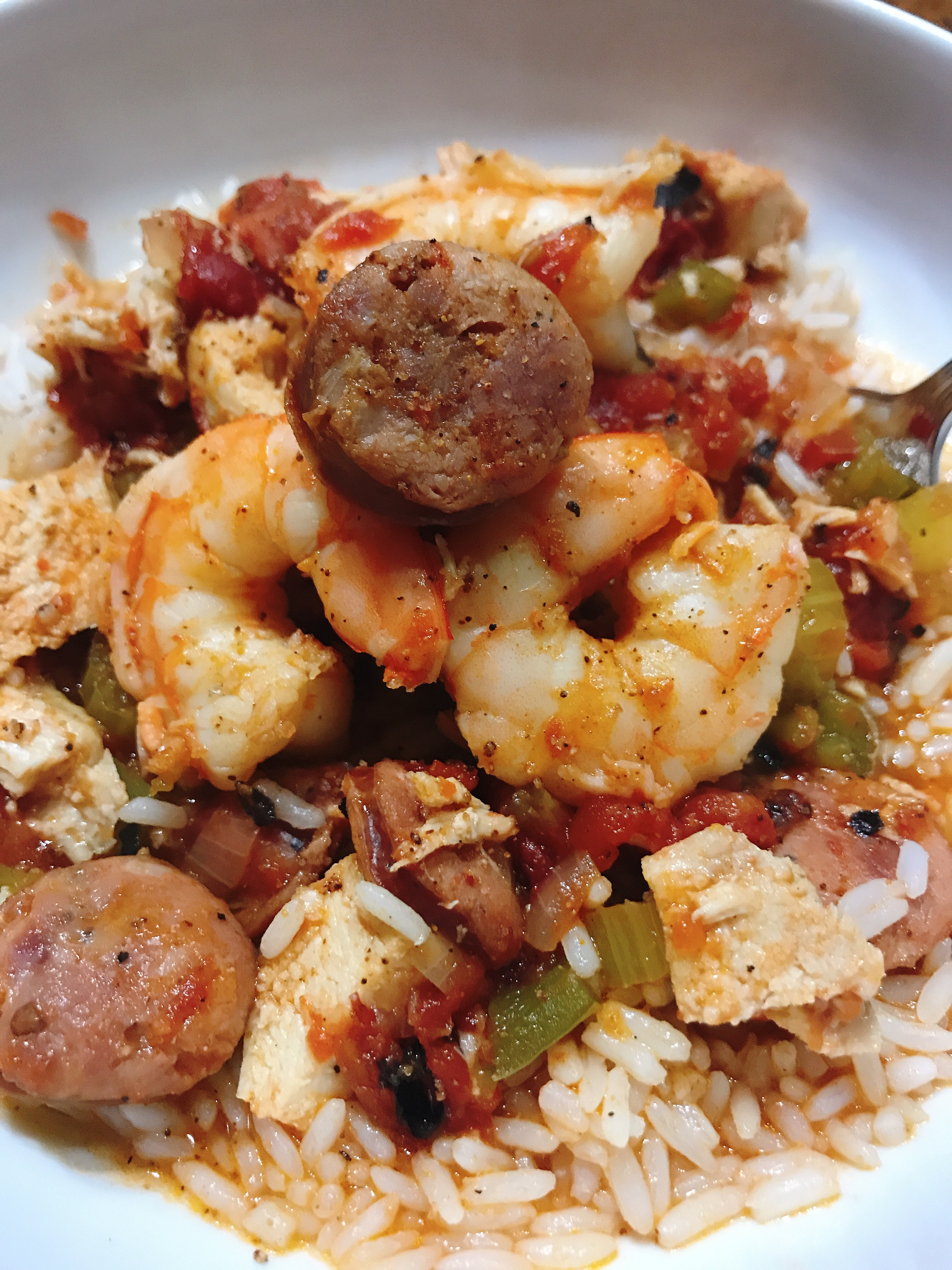 """Chicken, andouille sausage, shrimp, and the """"holy trinity"""" of onion, bell peppers, and celery get together in a classic Mardi Gras recipe that's ready in about an hour — and that includes the time it takes to cook the riceandthe jambalaya. Cajun and Creole seasonings amp up the heat and the flavor."""