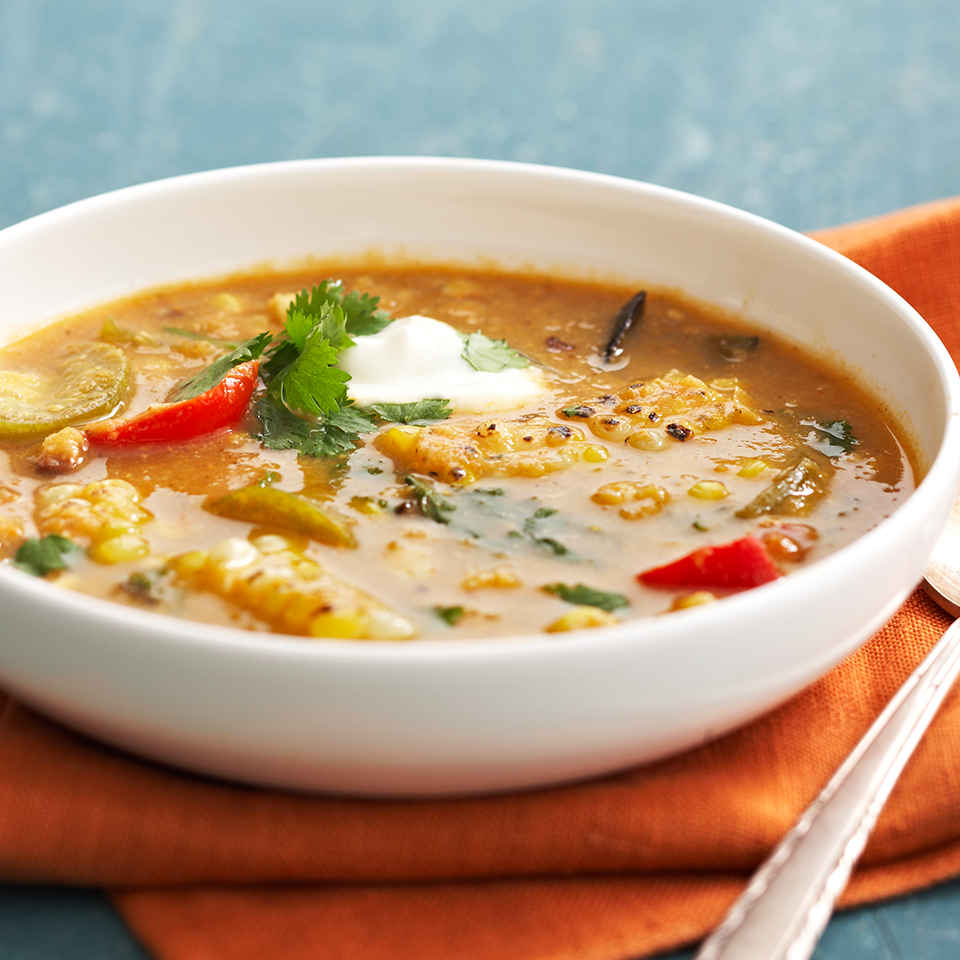 Roasting the corn and peppers in the oven before adding them to the soup adds intense flavor to this chowder recipe. Before serving, blend half of the soup to ensure a thicker base.