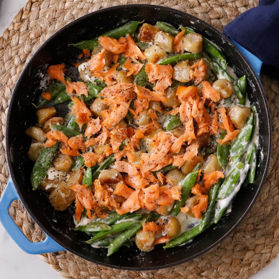 Tender cauliflower gnocchi combine with a quick cream sauce, tender peas and flaky salmon for an unforgettable weeknight dinner. This one is so good you might make it for special occasions. If you don't like smoked salmon, use fresh. Source: EatingWell.com, January 2019